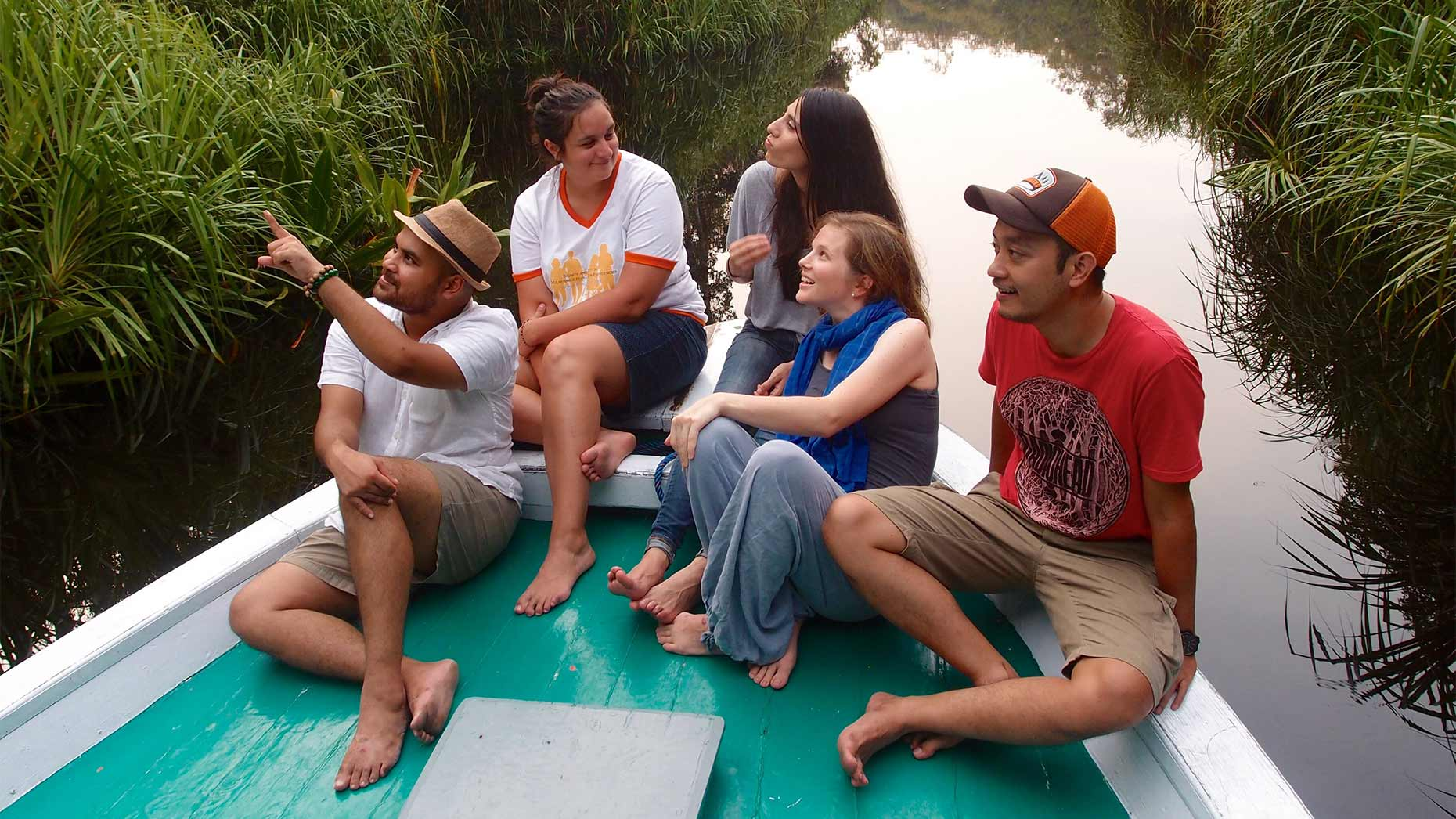 Five students floating down a river on a raft.